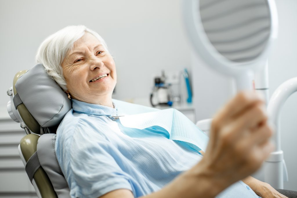 Elderly woman enjoying her smile dental implants on Toronto